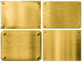 Gold metal plates or signboards set with rivets sign boards isolated on white Stock Images