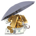 Gold and money under umbrella Stock Photo