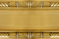 Gold neoclassical plaque Royalty Free Stock Photos