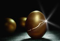 Gold nest egg coming to life Royalty Free Stock Photo