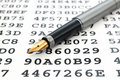 A gold-nibbed pen and encrypted data Royalty Free Stock Image