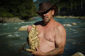 Gold miner, with nugget. Royalty Free Stock Photo