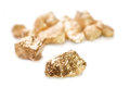 Gold nuggets on white background isolated Royalty Free Stock Image
