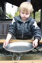 Gold panning Boy Stock Images