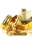 Gold and pearl jewelry gift boxes on a white background Royalty Free Stock Photos