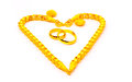 Gold pendants two rings and two bracelet in heart shape Royalty Free Stock Images