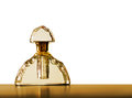 Gold perfume bottle, glass. Retro, over white Stock Photo