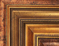 Gold picture frame samples Stock Images