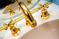 Gold plated taps Royalty Free Stock Photo