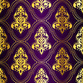 Gold-on-Purple seamless Indian pattern with dots Royalty Free Stock Photo