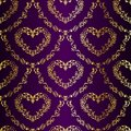 Gold-on-Purple seamless sari pattern with hearts Royalty Free Stock Photo
