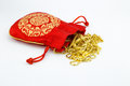 Gold and red bag ornament on white background Royalty Free Stock Images