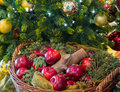 Gold and red decorations on xmas tree bright apples at base of christmas trees Stock Images