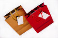 A gold and a red gift bag two bags one one isolated Stock Image