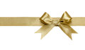Gold ribbon with bow isolated Royalty Free Stock Photo