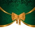 Gold ribbon on green ornament Royalty Free Stock Photo
