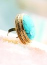 Gold ring big with turquoise Stock Images