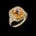 Gold ring with gemstone on black background Royalty Free Stock Photo