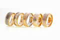 Gold rings five stacked on a white background Stock Photo