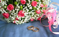 Gold rings for a wedding bouquet of roses Stock Image