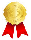 Gold seal with red ribbon Royalty Free Stock Photo