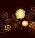 Gold seashells brown background with jewelry with and starfish Royalty Free Stock Images