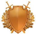 Gold shield with crossed swords on the background Stock Photo