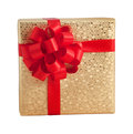 Gold shiny paper wrap gift box red ribbon present christmas birthday Royalty Free Stock Photo