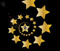 Gold shooting stars in spiral on black background Royalty Free Stock Photo