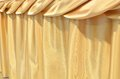 Gold silk tablecloth background texture Royalty Free Stock Images