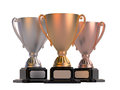 Gold, silver and bronze cups Royalty Free Stock Photo