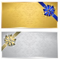 Gold and silver gift voucher with bow isolated on white Stock Images
