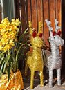 Gold and Silver paper deers with yellow flower Royalty Free Stock Photo