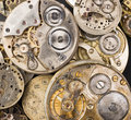 Gold silver precision antique vintage pocket watch bodies parts a pile of old watches in various states Stock Photos