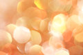 Gold, silver, red, white, orange abstract bokeh lights, defocused background Royalty Free Stock Photo