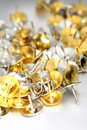 Gold and silver thumbtacks Royalty Free Stock Photo