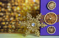 Gold snowflake with gift box violet Stock Photos