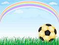 Gold soccer ball and rainbow Royalty Free Stock Photography