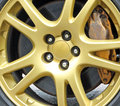 Gold sportscar racing wheel Royalty Free Stock Photo