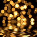 Gold spots bokeh background Royalty Free Stock Images