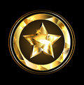 Gold star foil in the circle of over a black background Stock Image