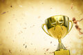 Gold star trophy on gold glitter background Royalty Free Stock Photo