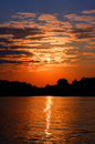 Gold sunset with clouds on the lake evening the feeling of tranquillity Royalty Free Stock Photos