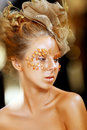 Gold teen fashion girl luxury golden makeup beautiful professional holiday make up art portrait Stock Images