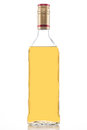 Gold tequila bottle Royalty Free Stock Photo