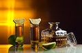 Gold tequila and lime on a glass table Stock Images
