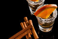 Gold tequila with orange and cinnamon on black reflect background Royalty Free Stock Photo