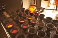 Gold testing molten is poured into receptacles for further and analysis in a laboratory Royalty Free Stock Photos