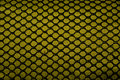 Gold texture of knitted fabric to form small spheres with a colored background Royalty Free Stock Images