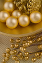 Gold textured bowl with objects Royalty Free Stock Photo